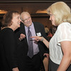 Barb Wolff, left, and Julie Moser, right former and current executive assistants to retired Broomfield City and County Manager George Di Ciero, center, reminisce about working for George during his retirement party at the Omni Interlocken Hotel and Resort on Saturday.<br /> July 30, 2011<br /> staff photo/ David R. Jennings