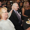 Pam Di Ciero, left,  wife of Retired Broomfield City and County Manager George Di Ciero gives him a pat as they laugh during a speech reminiscing about his 43 years of service during Saturday's retirement party for Di Ciero at the Omni Interlocken Hotel and Resort.<br /> July 30, 2011<br /> staff photo/ David R. Jennings