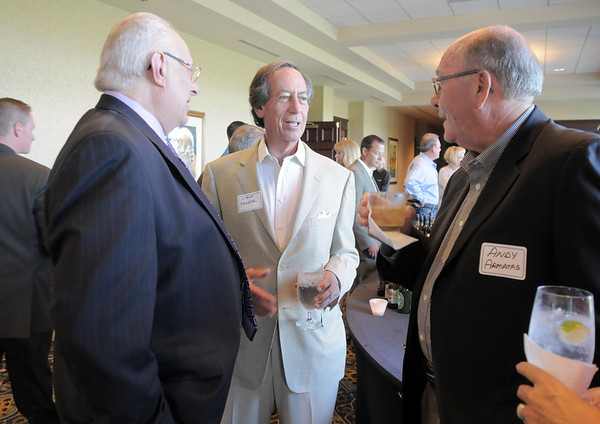 Retired Broomfield City and County Manager George Di Ciero, left, chats with long time friend Steve Farber, center, and Andy Armatas during Di Ciero's retirement party on Saturday at the Omni Interlocken Hotel and Resort.<br /> July 30, 2011<br /> staff photo/ David R. Jennings