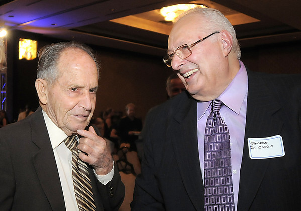 Retired Broomfield City and County Manager George Di Ciero, right, chats with former Broomfield mayor Clyde Brunner during Di Ciero's retirement party on Saturday at the Omni Interlocken Hotel and Resort. Brunner hired Di Ciero as the Broomfield City manager in 1968.<br /> July 30, 2011<br /> staff photo/ David R. Jennings