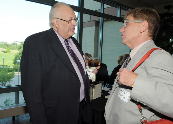 George Di Ciero, left, retired Broomfield City and County Manager chats with Chuck Morris during Di Ciero's retirement party, on Saturday, at the Omni Interlocken Hotel and Resort.<br /> July 30, 2011<br /> staff photo/ David R. Jennings