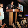 Mark Di Ciero and his daughter Alexa, 8, reminisces about his father, George Di Ciero, retired Broomfield City and County Manager, during George Di Ciero's retirement party at the Omni Interlocken Hotel and Resort on Saturday.<br /> July 30, 2011<br /> staff photo/ David R. Jennings