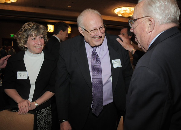 Suzanne Smith, left, listens as retired Broomfield City and County Manager George Di Ciero chats with Bob Davenport during Di Ciero's retirement party, on Saturday, at the Omni Interlocken Hotel and Resort.<br /> July 30, 2011<br /> staff photo/ David R. Jennings