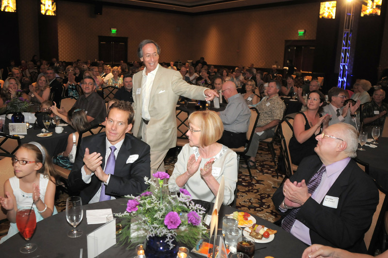 Walking to the podium, long time friend Steve Farber, center, points at retired Broomfield City and County Manager George Di Ciero, right, during Saturday's retirement party for Di Diero at the Omni Interlocken Hotel and Resort.<br /> July 30, 2011<br /> staff photo/ David R. Jennings