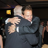 Mark Di Ciero gives his father George Di Ciero, retired Broomfield City and County Manager a hug during the retirement party for George Di Ciero, on Saturday, at the Omni Interlocken Hotel and Resort.<br /> July 30, 2011<br /> staff photo/ David R. Jennings