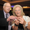 Retired Broomfield City and County Manager George Di Ciero, left, gives his executive assistant Julie Moser, earrings after Di Ciero's retirement party at the Omni Interlocken Hotel and Resort on Saturday.<br /> July 30, 2011<br /> staff photo/ David R. Jennings