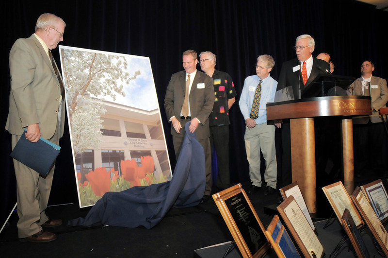 Broomfield council members unveil the the poster snnouncing naming the city and county building after retired Broomfield City and County Manager George Di Ciero during Di Ciero's retirement party, on Saturday, at the Omni Interlocken Hotel and Resort.<br /> July 30, 2011<br /> staff photo/ David R. Jennings