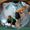 Brenda Wiegert, left, and fellow life guard Corey Davisson  clean and polish the 136 foot long slide during the cleaning and repair work of the Derda Recreation Center on Wednesday.<br /> <br /> August 26, 2009<br /> staff photo/David R. Jennings