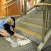 Melissa Kennington paints the edges of steps during the cleaning a repair of the Derda Recreation Center on Thursday.<br /> <br /> August 27, 2009<br /> staff photo/David R. Jennings