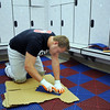Shane Mortensen cuts new mat tiles in the women's locker room  during the cleaning and repair of the Derda Recreation Center on Wednesday.<br /> <br /> August 26, 2009<br /> staff photo/David R. Jennings