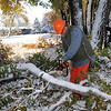 Chuck Gehringer, parks operations for the Broomfield City and County, on Wednesday, cuts tree branches that fell in Northmoor Park due to the October snow storm earlier this week.<br /> October 27, 2011<br /> staff photo/ David R. Jennings