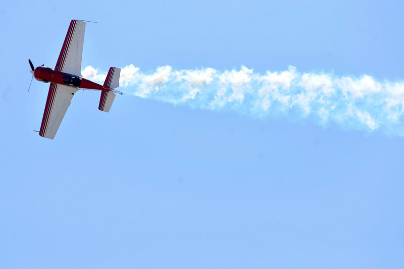 An airplane does tricks for the crowds at the Colorado Sport International Air Show on Saturday, Aug. 22, 2009 at the Rocky Mountain Metropolitan Airport in Broomfield. <br /> <br /> VIDEO INLINE: VIDEO: VIDEO: BROOM AIR SHOW 2009<br /> <br /> Photo by Mara Auster/Daily Camera
