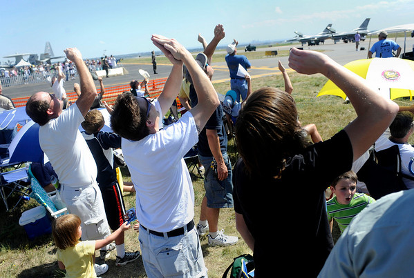 """N0923AIR7.jpg Spectators shield their eyes from the sun as an airplane does aerobatic tricks during the Colorado Sport International Air Show on Saturday, Aug. 22, 2009 at the Rocky Mountain Metropolitan Airport in Broomfield. Watch the video and see more photos at  <a href=""""http://www.dailycamera.com"""">http://www.dailycamera.com</a>.<br /> <br /> VIDEO INLINE: VIDEO: VIDEO: BROOM AIR SHOW 2009<br /> <br /> Photo by Mara Auster/Daily Camera"""