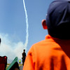 Grant Blayter, 6, watches an airplane do tricks for the crowds at the Colorado Sport International Air Show on Saturday, Aug. 22, 2009 at the Rocky Mountain Metropolitan Airport in Broomfield. <br /> <br /> VIDEO INLINE: VIDEO: VIDEO: BROOM AIR SHOW 2009<br /> <br /> Photo by Mara Auster/Daily Camera