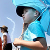 Rusty Blayter, 7, and his brother Grant Blayter, 6, watch airplane aerobatic tricks during the Colorado Sport International Air Show on Saturday, Aug. 22, 2009 at the Rocky Mountain Metropolitan Airport in Broomfield. <br /> <br /> VIDEO INLINE: VIDEO: VIDEO: BROOM AIR SHOW 2009<br /> <br /> Photo by Mara Auster/Daily Camera