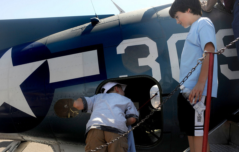 Jakob Maenpa, 9, right, and Tyler Williams, 10, check out a fighter plane during the Colorado Sport International Air Show on Saturday, Aug. 22, 2009 at the Rocky Mountain Metropolitan Airport in Broomfield.<br /> <br /> Photo by Mara Auster/Daily Camera