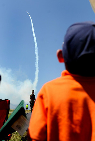 "N0923AIR1.jpg Grant Blayter (CQ), 6, watches an airplane do tricks for the crowds at the Colorado Sport International Air Show on Saturday, Aug. 22, 2009 at the Rocky Mountain Metropolitan Airport in Broomfield. Watch the video and see more photos at  <a href=""http://www.dailycamera.com"">http://www.dailycamera.com</a>.<br /> <br /> VIDEO INLINE: VIDEO: VIDEO: BROOM AIR SHOW 2009<br /> <br /> Photo by Mara Auster/Daily Camera"