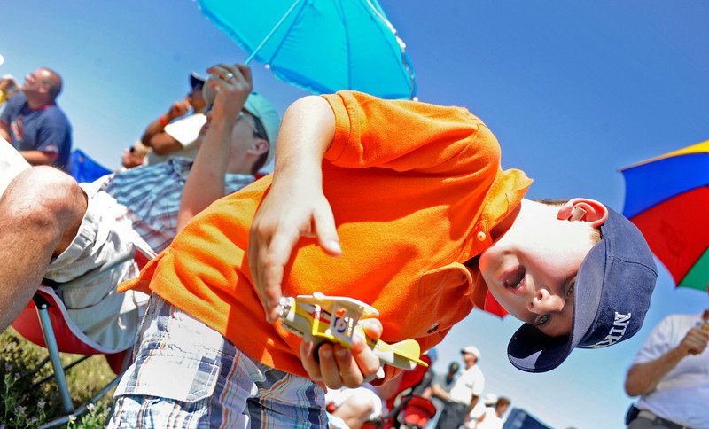 """N0923AIR2.jpg Grant Blayter (CQ), 6, plays with his toy airplane during the Colorado Sport International Air Show on Saturday, Aug. 22, 2009 at the Rocky Mountain Metropolitan Airport in Broomfield. Watch the video and see more photos at  <a href=""""http://www.dailycamera.com"""">http://www.dailycamera.com</a>.<br /> <br /> VIDEO INLINE: VIDEO: VIDEO: BROOM AIR SHOW 2009<br /> <br /> Photo by Mara Auster/Daily Camera"""