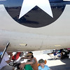 "N0923AIR4.jpg Luke Crumplar, 5, from right, his mother Joyce, brother Sean Jr., 8, sister Ava, 1, and father Sean Sn. all cool off in the shade of a large airplane during the Colorado Sport International Air Show on Saturday, Aug. 22, 2009 at the Rocky Mountain Metropolitan Airport in Broomfield. Watch the video and see more photos at  <a href=""http://www.dailycamera.com"">http://www.dailycamera.com</a>.<br /> <br /> VIDEO INLINE: VIDEO: VIDEO: BROOM AIR SHOW 2009<br /> <br /> Photo by Mara Auster/Daily Camera"