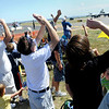 Spectators shield their eyes from the sun as an airplane does aerobatic tricks during the Colorado Sport International Air Show on Saturday, Aug. 22, 2009 at the Rocky Mountain Metropolitan Airport in Broomfield. <br /> <br /> VIDEO INLINE: VIDEO: VIDEO: BROOM AIR SHOW 2009<br /> <br /> Photo by Mara Auster/Daily Camera