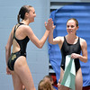 Monarch's Savannah Magness, left,  does a high five with teammate Grace Newell after a dive during the Colorado Coaches Association Invitational at the Veterans Memorial Aquatic Center in Thornton on Saturday.<br /> December 14, 2012<br /> staff photo/ David R. Jennings