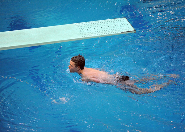Broomfield's Cody Engstrom swims back to the pool edge after a dive during the Dick Rush Coach's Invitational Swim Meet at the Veterans Memorial Aquatic Center in Thornton on Saturday.<br /> March 31, 2012 <br /> staff photo/ David R. Jennings