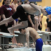 Broomfeild<br /> s Martin Wallace launches off of the blocks his leg of 400 yard relay during the Dick Rush Coach's Invitational Swim Meet at the Veterans Memorial Aquatic Center in Thornton on Saturday.<br /> March 31, 2012 <br /> staff photo/ David R. Jennings
