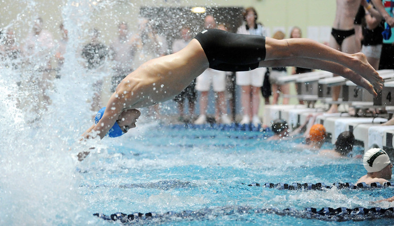 Broomfield's Alex Prins launches  off the blocks as Kris Kerr finishes during the 200 yard relay event at the Dick Rush Coach's Invitational Swim Meet at the Veterans Memorial Aquatic Center in Thornton on Saturday.<br /> March 31, 2012 <br /> staff photo/ David R. Jennings