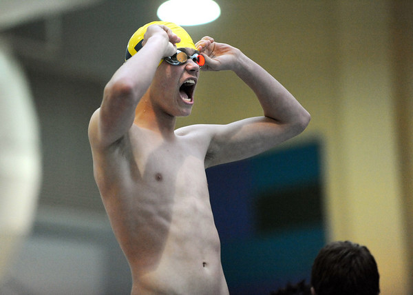 Legacy's Kilan Orrino cheers on his team mate before swimming his leg in 400 yard relay during the Dick Rush Coach's Invitational Swim Meet at the Veterans Memorial Aquatic Center in Thornton on Saturday.<br /> March 31, 2012 <br /> staff photo/ David R. Jennings