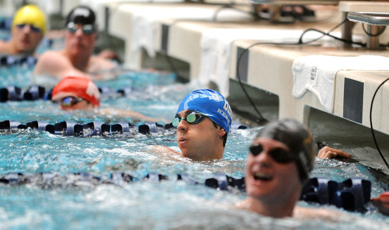 Broomfield's Kris Kerr, center, looks at his time in the 50 yard freestyle yard event during the Dick Rush Coach's Invitational Swim Meet at the Veterans Memorial Aquatic Center in Thornton on Saturday.<br /> March 31, 2012 <br /> staff photo/ David R. Jennings