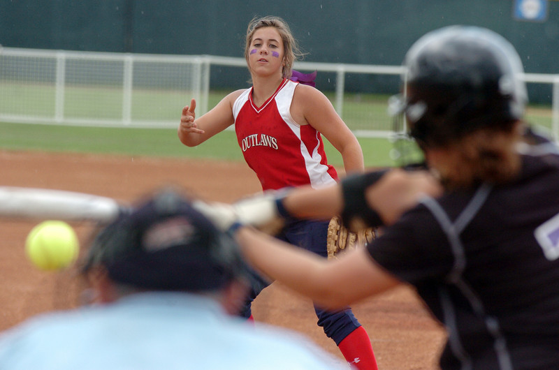 Texas Outlaws pitcher Kayla Ober throws against Oregon Thunder's Courtney Houston during the 14U Colorado Fireworks Softball Tournament championship game between the Texas Outlaws and Oregon Thunder at the Community Park ball fields on Sunday.<br /> <br /> July 4, 2010<br /> Staff photo/ David R. Jennings