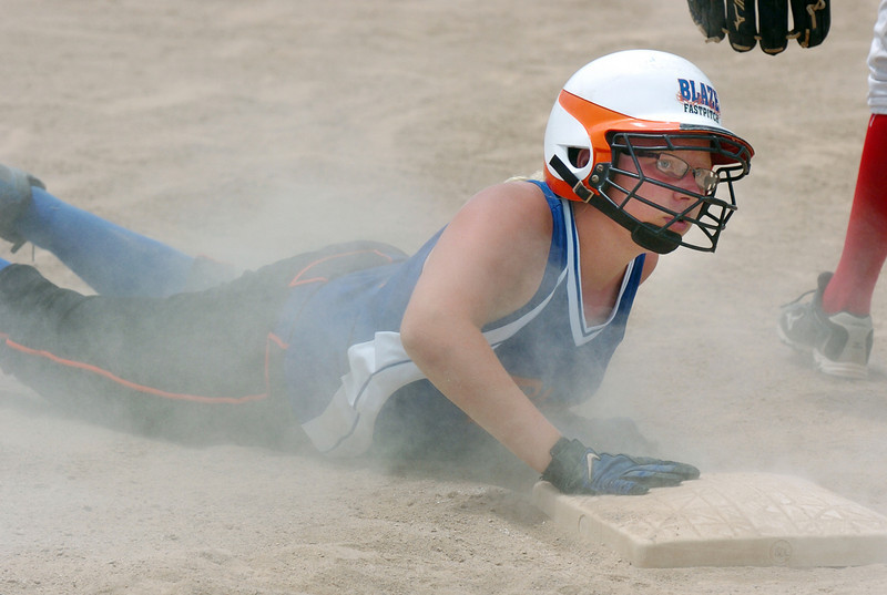 BE0708SOFT12U05<br /> Blaze Fastpitch Alissa Jones slides to third base during the 12U Colorado Fireworks Softball Tournament championship game between the Texas Hawks and Oklahoma BLaze Fastpitch at the Community Park ball fields on Sunday.<br /> <br /> July 4, 2010<br /> Staff photo/ David R. Jennings