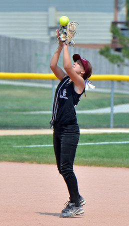 "Emily Morrow, Orange County Batbuster catches a hit by the Indiana Magic Gold during the championship game for the 2012 Colorado Freedom Girl's Softball Invitational at Community Park on Friday.<br /> <br /> July 4, 2012<br /> staff photo/ David R. Jennings<br /> <br /> More photos and video please go to <br />  <a href=""http://www.broomfieldenterprise.com"">http://www.broomfieldenterprise.com</a>"