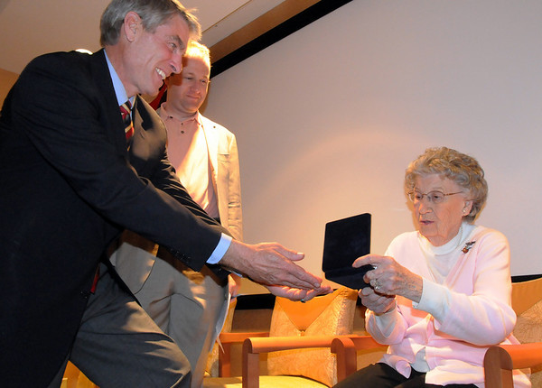 Senator Mark Udall, left, and Congressman Jared Polis give Josephine Kater Robinson, 92, a WWII WASP, Women Airforce Service Pilots, her Congressional Gold Medal during the ceremony at The Stratford at the Flatirons on Saturday.<br /> May 22, 2010<br /> Staff photo/ David R. Jennings