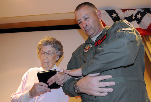 Major General H. Michael Edwards, right, listens to a prayer with Josephine Kater Robinson, 92, a WWII WASP, Women Airforce Service Pilots, holding her Congressional Gold Medal during the ceremony at The Stratford at the Flatirons on Saturday.<br /> May 22, 2010<br /> Staff photo/ David R. Jennings