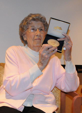 Josephine Kater Robinson, 92, a WWII WASP, Women Airforce Service Pilots, shows the audience her Congressional Gold Medal during the ceremony at The Stratford at the Flatirons on Saturday.<br /> May 22, 2010<br /> Staff photo/ David R. Jennings