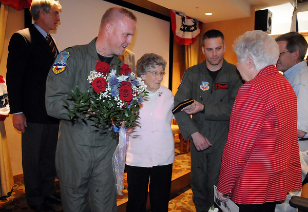 After receiving her Congressional Gold Medal Josephine Kater Robinson, 92, second left, a WWII WASP, Women Airforce Service Pilots, escorted by Capt. Teneyck Latourrette and 1st. Lt. Carson Brusch, chats with fellow WASP Lucile Doll Wise, right, at The Stratford at the Flatirons on Saturday.<br /> May 22, 2010<br /> Staff photo/ David R. Jennings