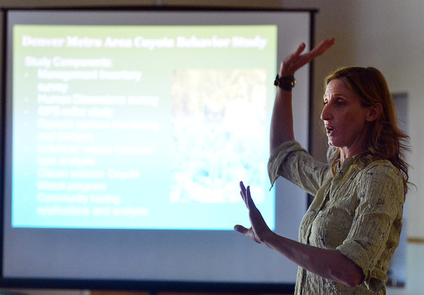 Mary Ann Bonnell, City of Aurora naturalist, explains coyote behavior  study during her coyote observer training course as a part of the Denver Metro Area Coyote Behavior Study at the Broomfield Community Center on Thursday.<br /> June21, 2012<br /> staff photo/ David R. Jennings