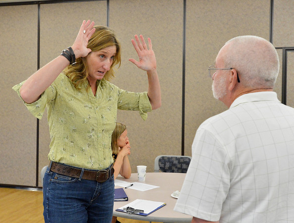 Mary Ann Bonnell, left, City of Aurora naturalist, talks with Allen Coyle during her Coyote observer training course as a part of the Denver Metro Area Coyote Behavior Study at the Broomfield Community Center on Thursday.<br /> June21, 2012<br /> staff photo/ David R. Jennings