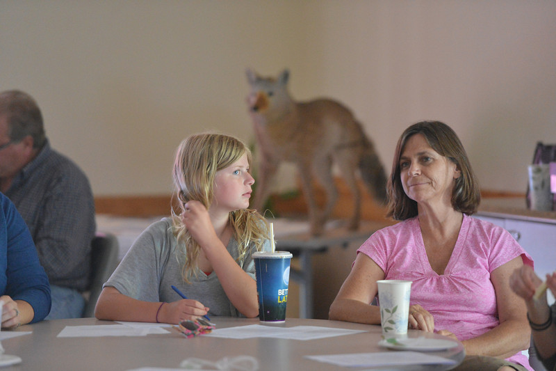 Francie Traxler, 12, left, and Pascale Fried listen to Mary Ann Bonnell, City of Aurora naturalist, explaining different behaviors of coyotes during the Coyote observer training course as a part of the Denver Metro Area Coyote Behavior Study at the Broomfield Community Center on Thursday.<br /> June21, 2012<br /> staff photo/ David R. Jennings