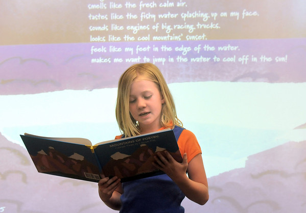 "Maddie Hayes reads her poem ""Boating"" during the book release party of Coyote Authors Club book, Mountains of Poetry: Colorado Poems by Colorado Kids at Coyote Ridge Elementary School on Tuesday.<br /> May 3, 2011<br /> staff photo/David R. Jennings"