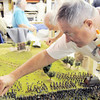Kent Strapko re-glues a small figure of a Civil War soldier on the Broomfield Veterans Memorial Museum diorama depicting Pickett's Charge at the Battle of Gettysburg at Fine Art Mannequins studio on Wednesday.<br /> <br /> July 6 2011<br /> staff photo/ David R. Jennings