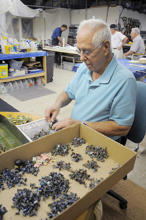 Broomfield Veterans Memorial Museum member Robert Davis takes bases off of small figures of Civil War soldiers for the diorama depicting Pickett's Charge at the Battle of Gettysburg at Fine Art Mannequins studio in June.<br /> July 6 2011<br /> staff photo/ David R. Jennings