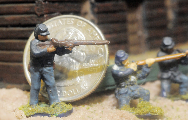 An HO scale figure of Civil War soldier is shown in comparison to a Quarter coin on the Broomfield Veterans Memorial Museum diorama depicting Pickett's Charge at the Battle of Gettysburg at Fine Art Mannequins studio on Wednesday.<br /> July 6 2011<br /> staff photo/ David R. Jennings
