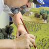 Rod Postillion dusts flock off of small figures of Civil War soldiers on the Broomfield Veterans Memorial Museum diorama depicting Pickett's Charge at the Battle of Gettysburg at Fine Art Mannequins studio on Wednesday.<br /> July 6 2011<br /> staff photo/ David R. Jennings
