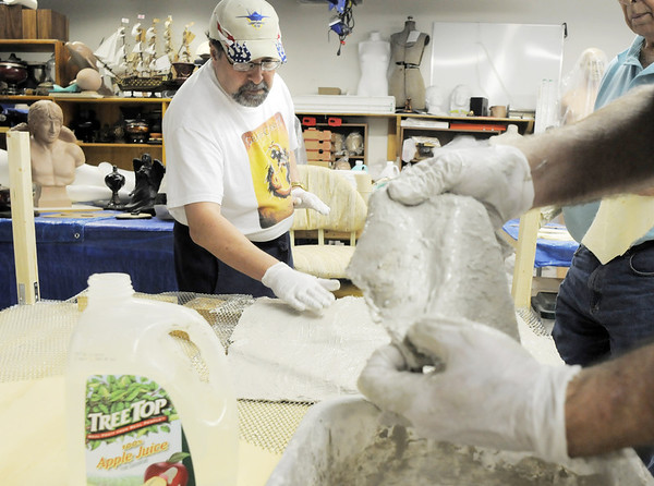 Rod Postillion, left, and Joseph P. Jonas work on laying squares of burlap dipped in gypsum for the ground of the Broomfield Veterans Memorial Museum diorama depicting Pickett's Charge at the Battle of Gettysburg at Fine Art Mannequins studio in June.<br /> July 6 2011<br /> staff photo/ David R. Jennings