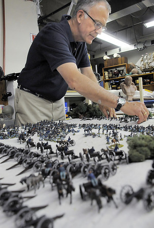 Mike Fellows helps to arrange small figures of Civil War soldiers on the Broomfield Veterans Memorial Museum diorama depicting Pickett's Charge during the Battle of Gettysburg at Fine Art Mannequins studio in June.<br /> July 6 2011<br /> staff photo/ David R. Jennings