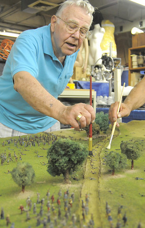 Marv Eakes dusts flock off of small Civil War soldiers figures on the Broomfield Veterans Memorial Museum diorama depicting Pickett's Charge at the Battle of Gettysburg at Fine Art Mannequins studio on Wednesday.<br /> July 6 2011<br /> staff photo/ David R. Jennings
