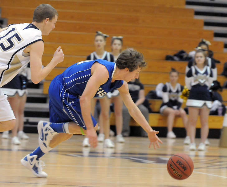 Legacy's Travis Baum and Broomfield's Austin Wood scramble after a loose ball during Saturday's cross town game at Legacy.<br /> January 7, 2012<br /> staff photo/ David R. Jennings