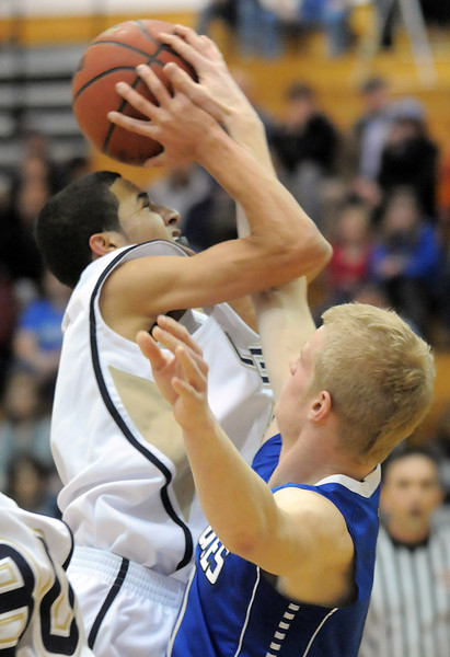 Legacy's Marcus Riddick shoots the ball against Broomfield's Dan Perse during Saturday's cross town game at Legacy.<br /> <br /> January 7, 2012<br /> staff photo/ David R. Jennings